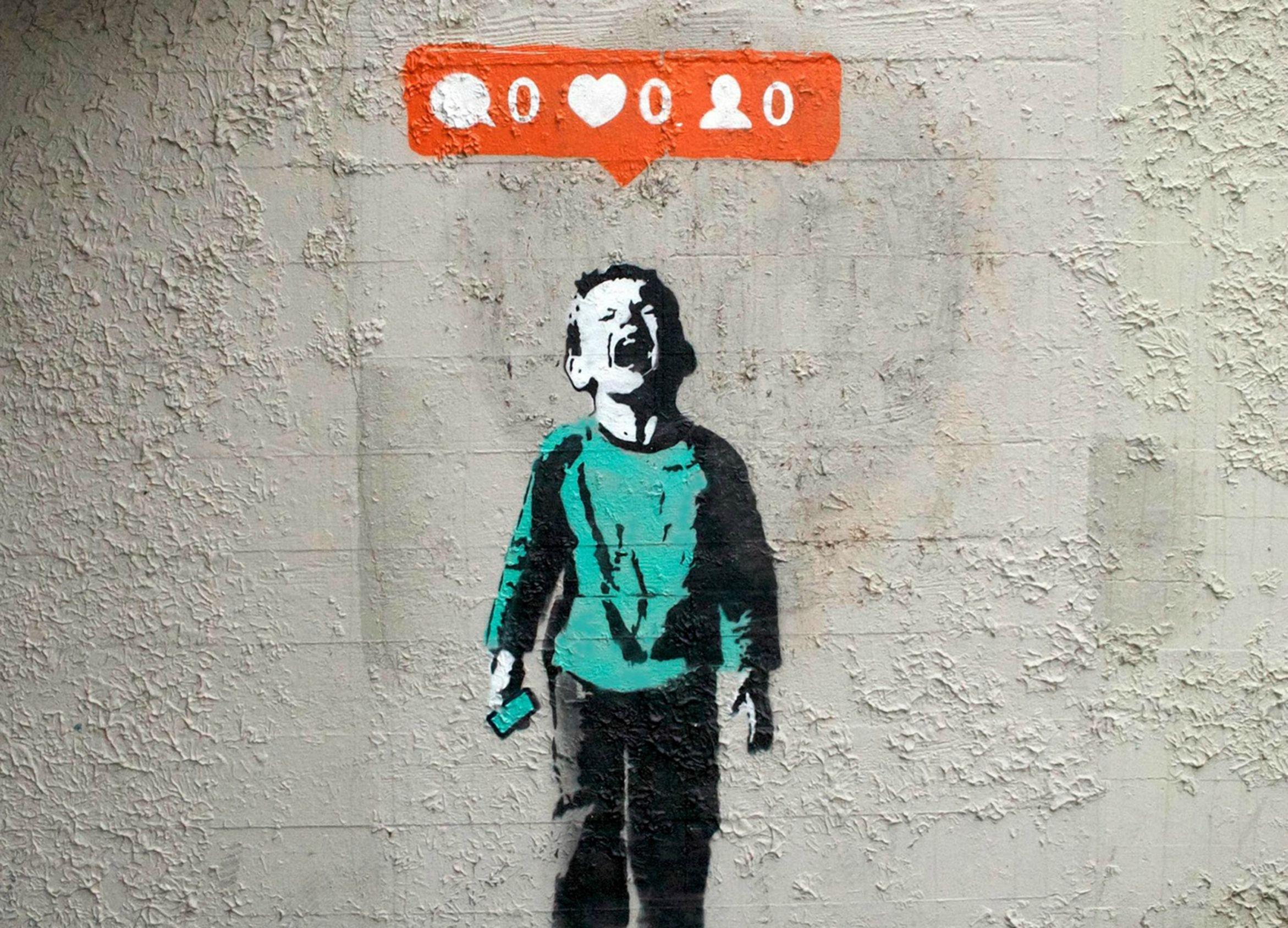 Graffito di Bansky che ritrae un bambino che piange per pochi like ricevuti senza i bot di Instagram